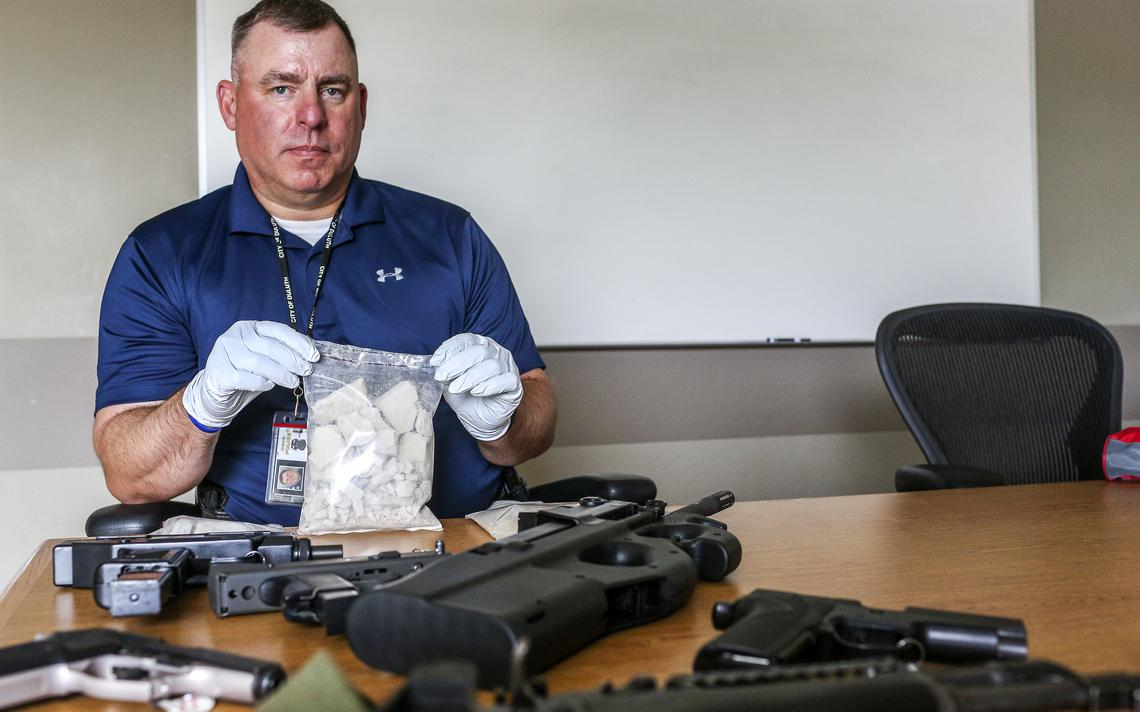 Lt. Jeff Kazel, commander of the Lake Superior Drug and Violent Crime Task Force, holds a bag containing approximately one pound of brown heroin at the Duluth Police Department. The bag contains about 5,000 doses of the drug with an estimated street value $70,000. The items and drugs were confiscated during drug related arrests.  (Clint Austin / Forum News Service)